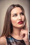 Mujer joven que es confusa Imagen de archivo libre de regalías