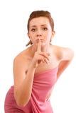 Mujer joven que gesticula silencio Imagenes de archivo