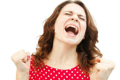 Mujer joven que grita con la alegría, aislada Fotos de archivo libres de regalías