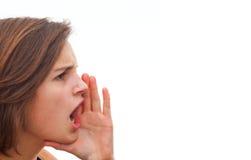 Mujer joven que grita en el espacio de la copia Fotografía de archivo libre de regalías