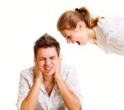 Mujer joven que grita en el hombre Imagen de archivo