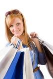 Mujer joven que hace compras con el bolso Fotografía de archivo libre de regalías
