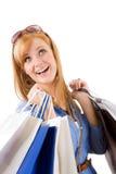Mujer joven que hace compras con el bolso Foto de archivo libre de regalías