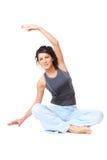 Mujer joven que hace ejercicio imagenes de archivo