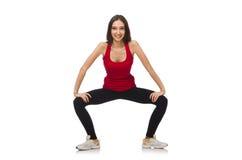 Mujer joven que hace ejercicios del deporte imagenes de archivo