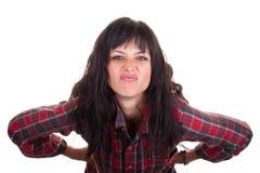 Mujer joven que hace una cara Imagen de archivo libre de regalías