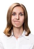 Mujer joven que hace una expresión del abadejo Fotos de archivo