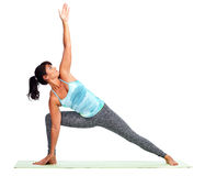 Mujer joven que hace yoga Imagen de archivo