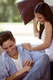 Mujer joven que juega con su novio Imágenes de archivo libres de regalías