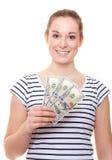 Mujer joven que lleva a cabo 300 dólares Imagen de archivo libre de regalías
