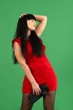 Mujer joven que lleva el vestido rojo con emociones Foto de archivo libre de regalías