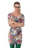 Mujer joven que lleva a Mini Dress And Glasses apretado corto Imagenes de archivo