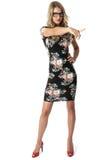 Mujer joven que lleva a Mini Dress Pointing corto Foto de archivo libre de regalías