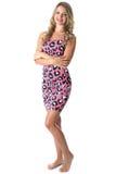 Mujer joven que lleva a Mini Dress rosado Fotos de archivo libres de regalías
