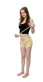 Mujer joven que mide su cintura Fotos de archivo