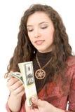 Mujer joven que muestra el dinero Fotos de archivo libres de regalías