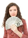 Mujer joven que muestra el dinero Fotografía de archivo