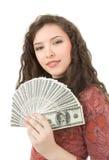 Mujer joven que muestra el dinero Fotos de archivo