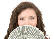 Mujer joven que muestra el dinero Imagen de archivo