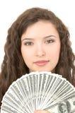 Mujer joven que muestra el dinero Foto de archivo libre de regalías