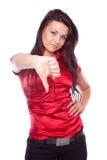 Mujer joven que muestra el pulgar abajo Fotos de archivo