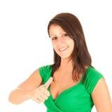 Mujer joven que muestra el pulgar para arriba Fotos de archivo
