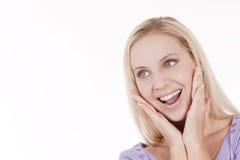 Mujer joven que parece excitada Fotografía de archivo libre de regalías