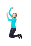 Mujer joven que salta con alegría Fotografía de archivo libre de regalías