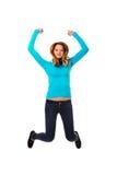 Mujer joven que salta con alegría Imagenes de archivo