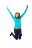 Mujer joven que salta con alegría Foto de archivo libre de regalías