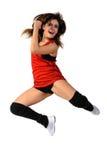 Mujer joven que salta en el fondo blanco Foto de archivo libre de regalías