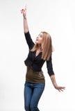 Mujer joven que señala al lado Imagen de archivo