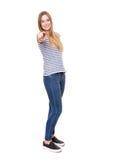 Mujer joven que señala con el dedo Fotografía de archivo