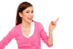 Mujer joven que señala el dedo Imagen de archivo