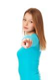 Mujer joven que señala en usted Fotografía de archivo libre de regalías