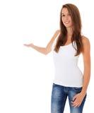 Mujer joven que señala a la cara Foto de archivo