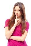 Mujer joven que sostiene el finger en los labios Imagen de archivo libre de regalías