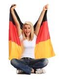 Mujer joven que sostiene el indicador alemán Fotografía de archivo libre de regalías