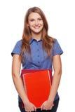 Mujer joven que sostiene los libros de texto Imagenes de archivo