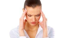 Mujer joven que sufre un dolor de cabeza Imagen de archivo libre de regalías