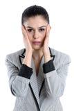 Mujer joven que tiene un dolor de cabeza Fotografía de archivo