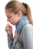 Mujer joven que tiene un frío Imagen de archivo