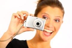 Mujer joven que toma cuadros Imagen de archivo