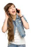 Mujer joven que usa el teléfono móvil Imágenes de archivo libres de regalías