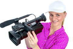Mujer joven rubia con la videocámara video profesional, en blanco Fotografía de archivo