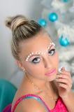 Mujer joven sensual con maquillaje Foto de archivo