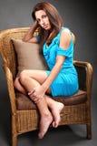 Mujer joven seria en silla Imágenes de archivo libres de regalías