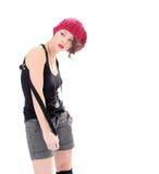 Mujer joven seria en sombrero rosado Foto de archivo