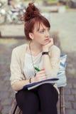 Mujer joven seria pensativa Imagen de archivo libre de regalías