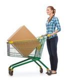 Mujer joven sonriente con el carro de la compra Imagen de archivo